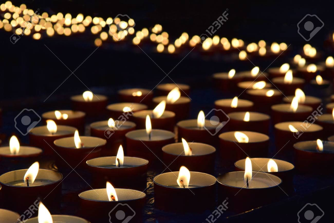 burning memorial candles on the dark background - 68182564