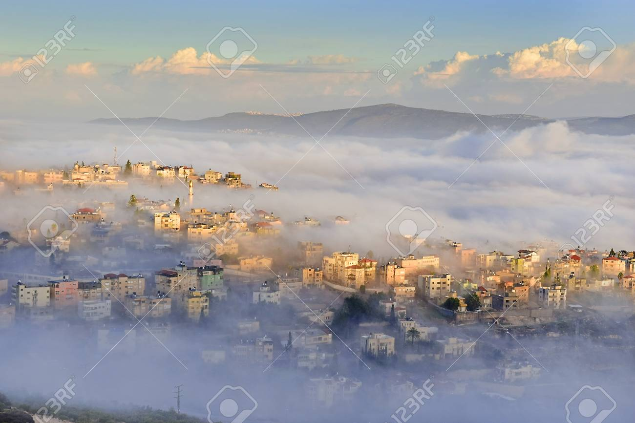 Stock Photo View Of The Shrouded In The Morning Fog Biblical Village Cana Of Galilee Kafr Kanna Neighborhood Nazareth In Israel Place Where Jesus