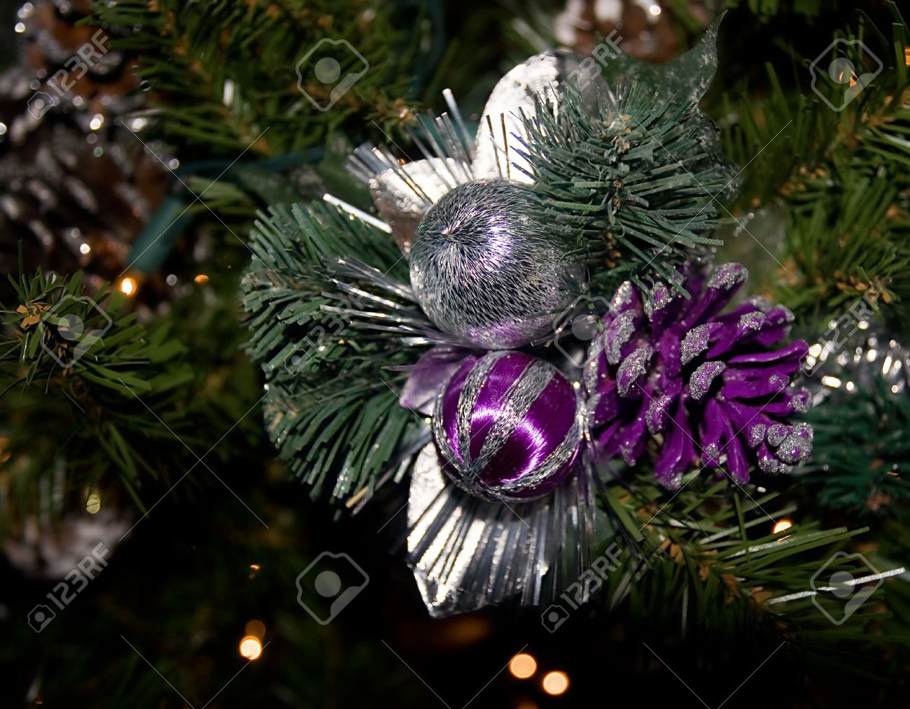 Close Up Of Christmas Ornaments And Lights On The Tree Purple