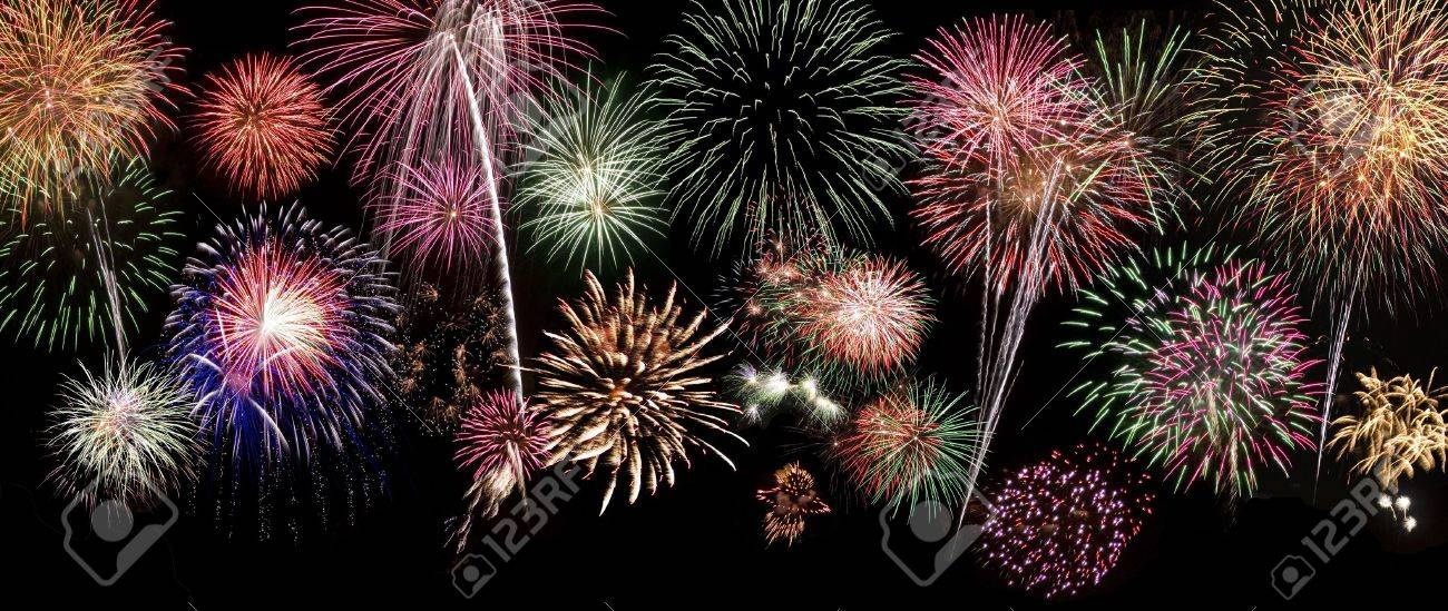 Large background of fireworks that you can apply to your design. This image is a composite of 10 separate photographs of real fireworks. The background is black so you can easily overlay it over any lanscape or city scape. Stock Photo - 2631542