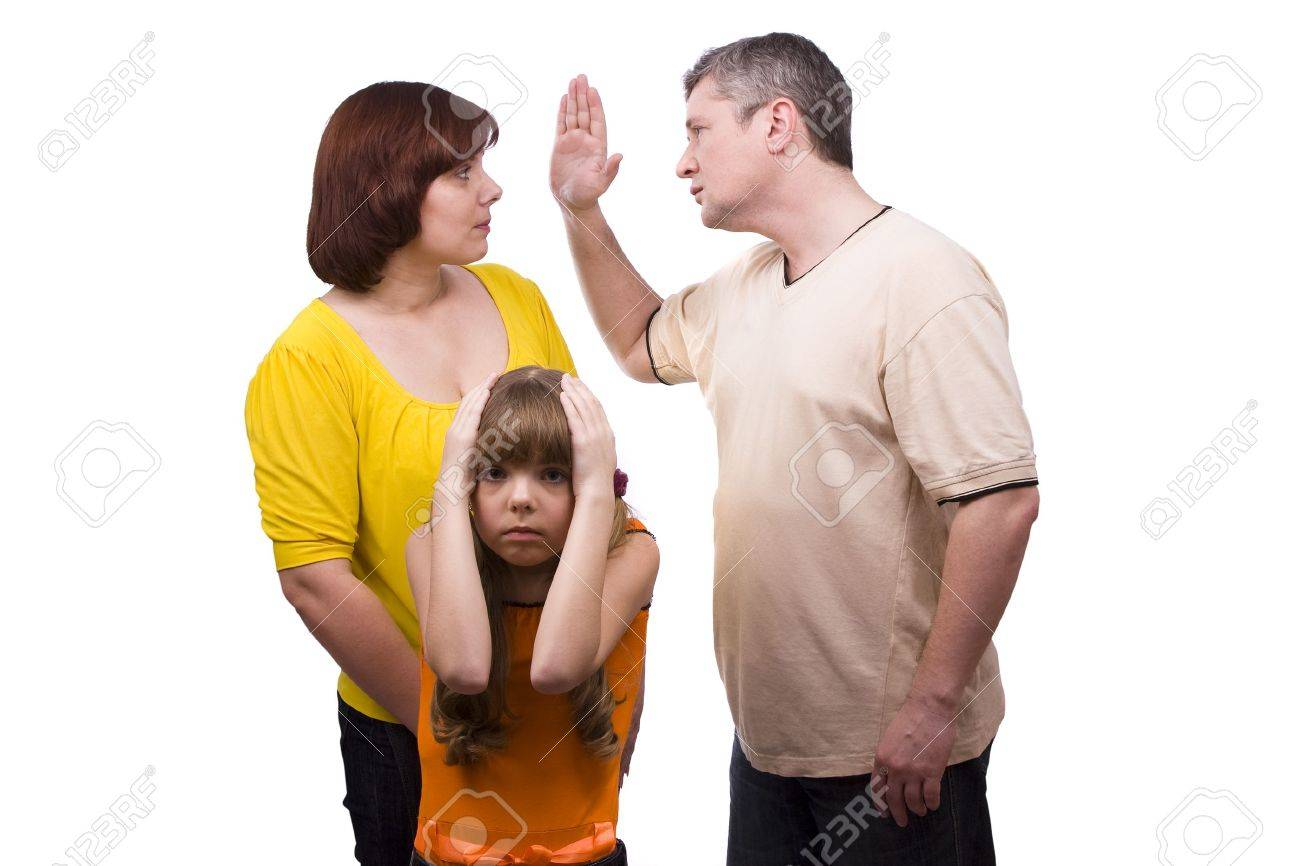 Husband is striking wife.  Parents swear, and children suffer. Girl suffers while parents argue vehemently in white background.  Couple fighting Stock Photo - 6228045