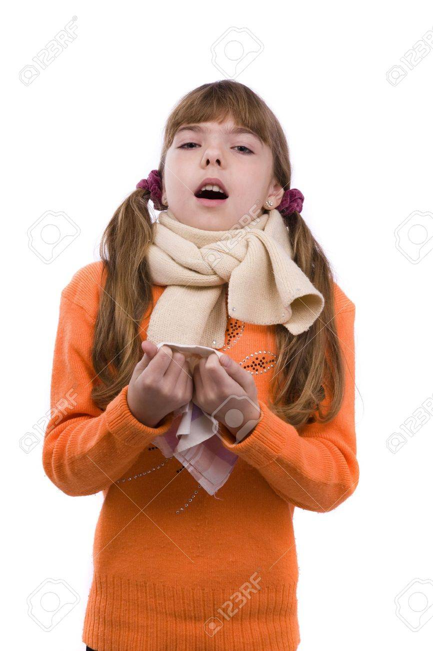 Sneezing. Little girl on white background in winter clothing is sick. Female have sore throat and sneezing. Stock Photo - 6307829