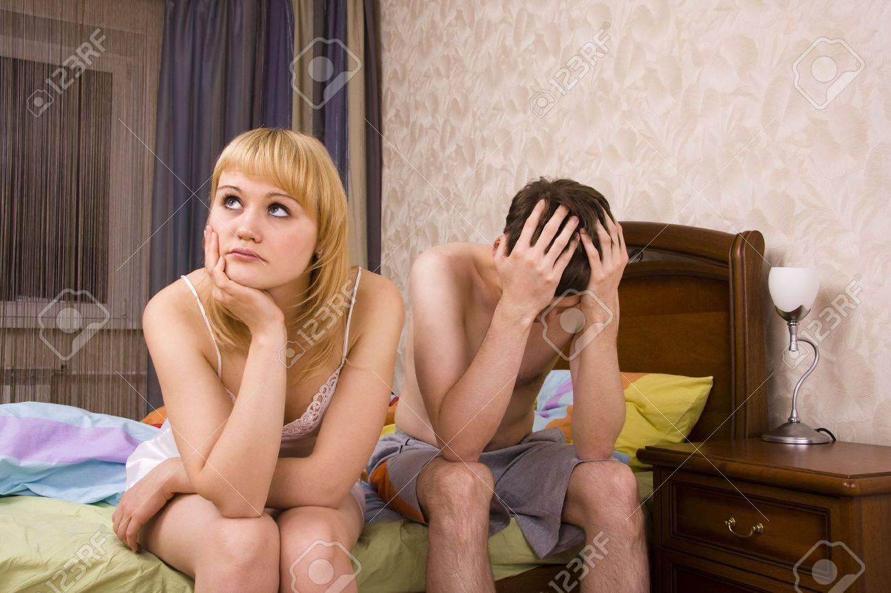 Young couple in a bed bored woman. Woman and man having a disagreement.Male and female with sad expressions. Stock Photo - 6307814