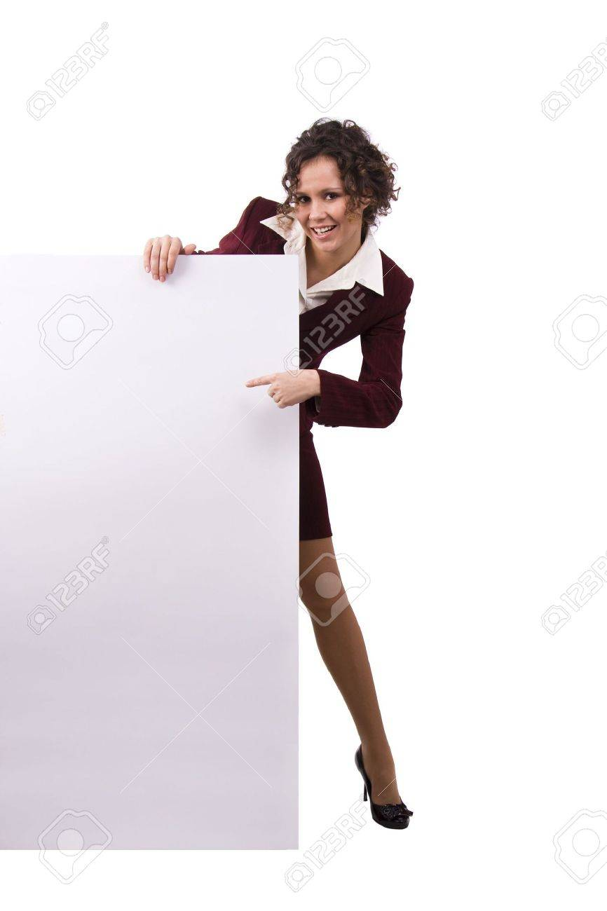 Whole-length portrait of businesswoman holding white blank card against isolated white background. A beautiful young business woman is holding a blank white sign. Business female standing beside a billboard Stock Photo - 6446288