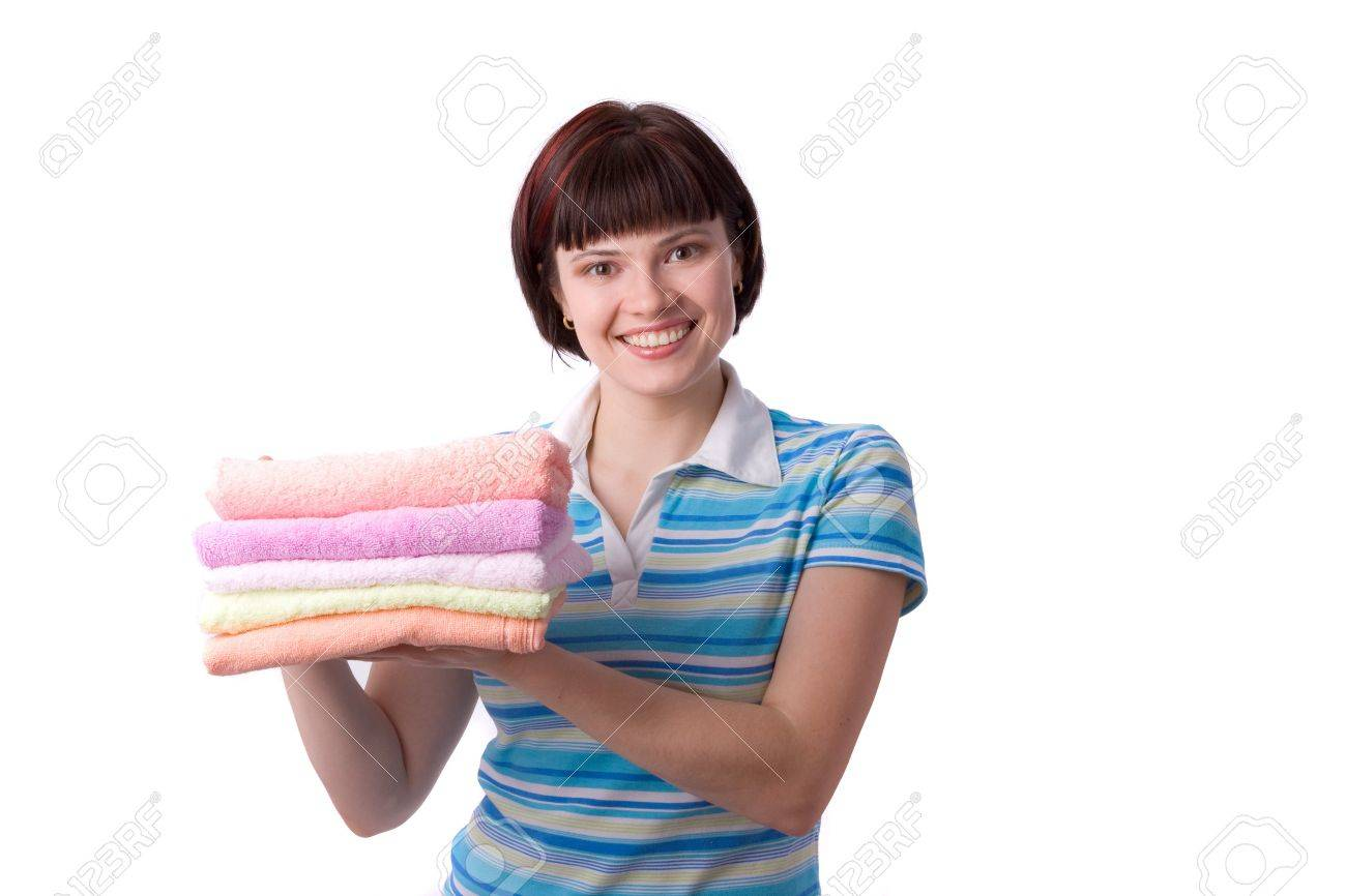 Housewife with clean laundry.  A young woman holding clean towels. Time for laundry day. Stock Photo - 7228375