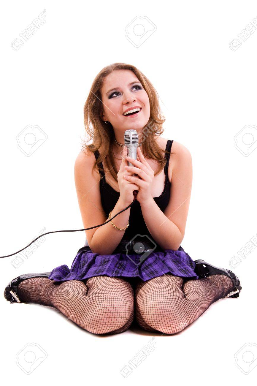 Singer. Young girl singing into microphone. Stock Photo - 8591434