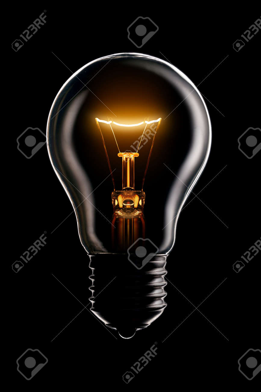 Glowing lamp on black background Stock Photo - 4373320