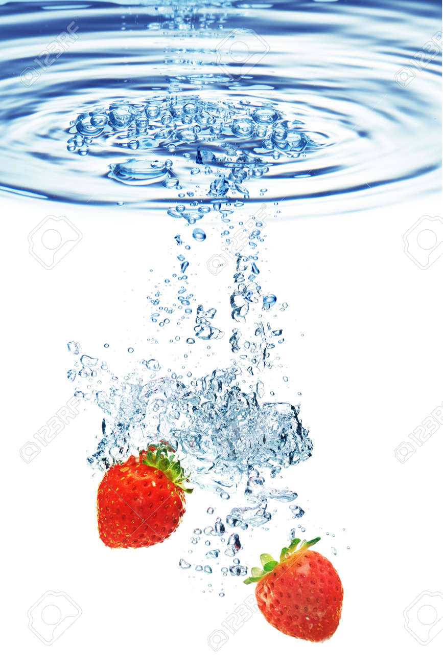 A background of bubbles forming in water after strawberries are dropped into it. Stock Photo - 5403151