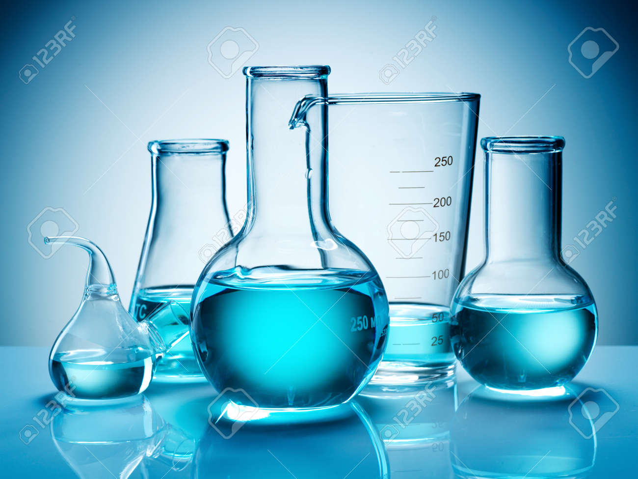 Assorted laboratory glassware equipment ready for an experiment in a science research lab - 7523980
