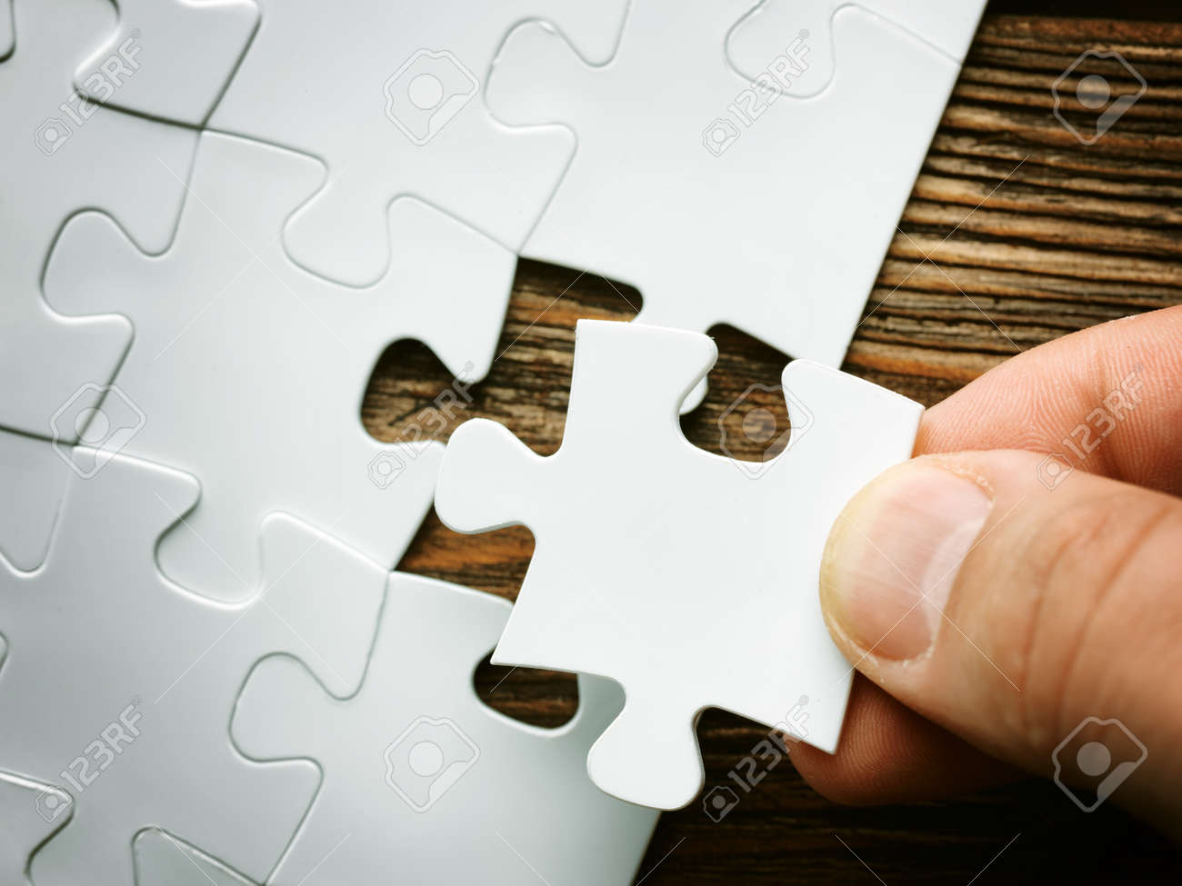hand with missing jigsaw puzzle piece business concept image