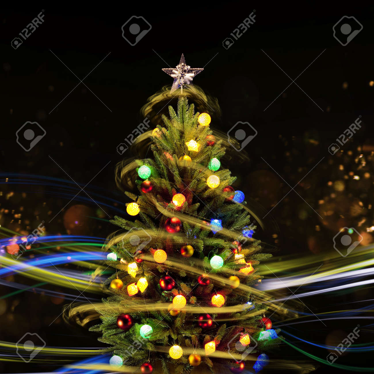 snow covered christmas tree with multi colored lights at night stock photo 66279283
