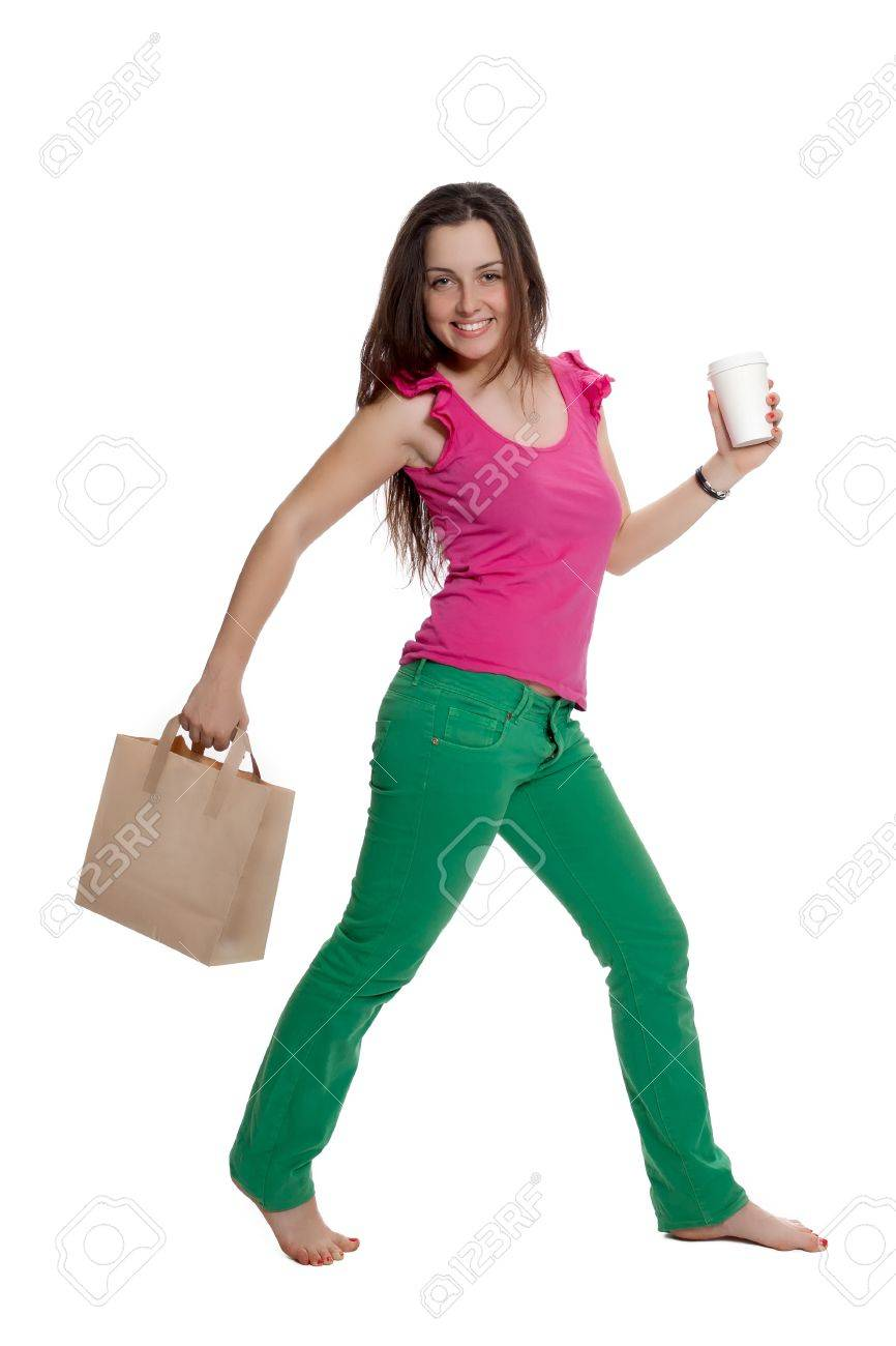 Beautiful girl with a bag and a coffee cup is walking Stock Photo - 10553406