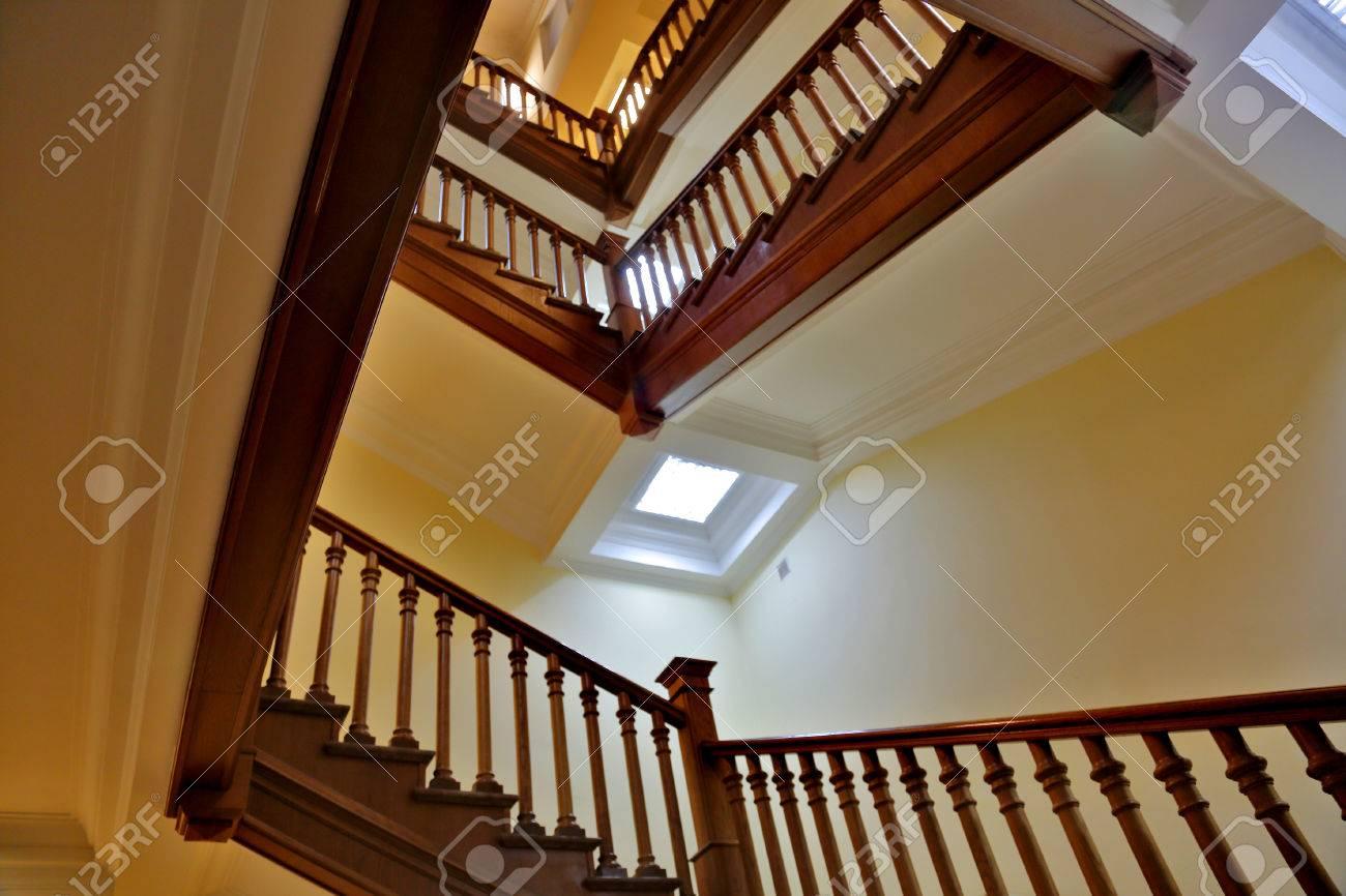 Brown Wood Staircase With A Handrail In A Building Without An Elevator  Stock Photo   69178290
