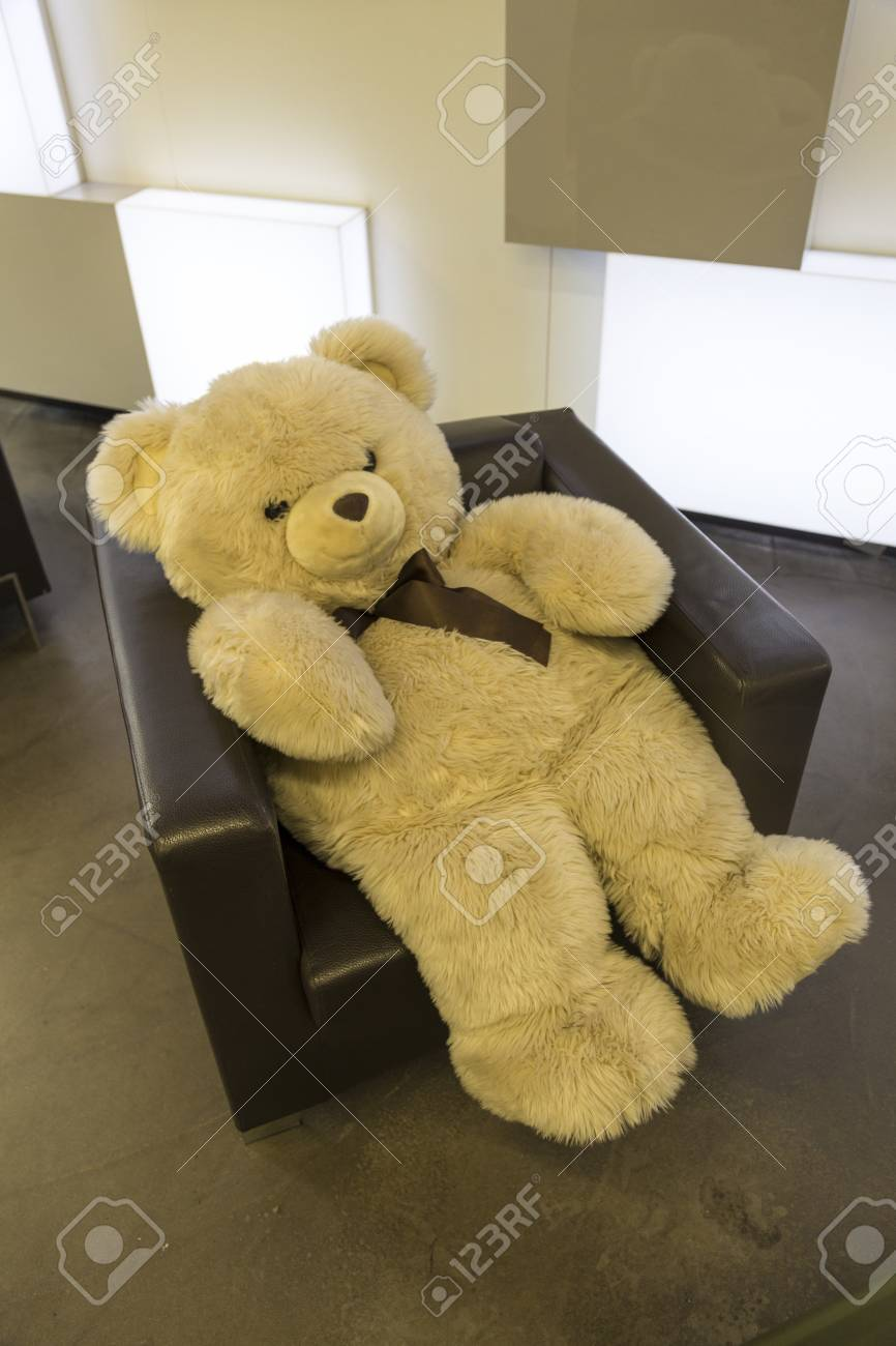 Hay Hay Chicken Stuffed Animal, Big Fluffy Teddy Bear Sitting In A Brown Leather Armchair Stock Photo Picture And Royalty Free Image Image 73676676