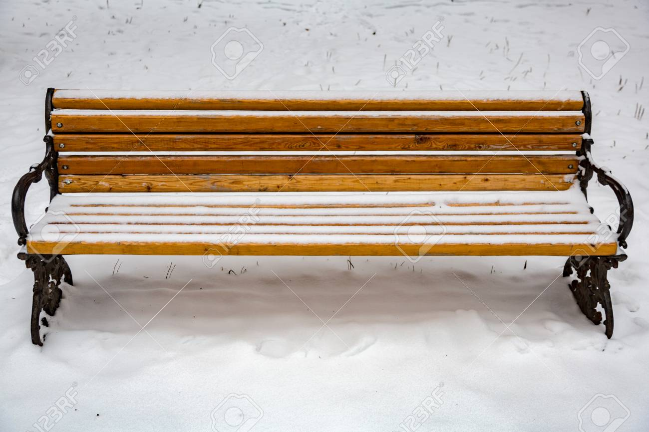 Old Wooden Bench In A Snow Covered City Park Stock Photo   91516529