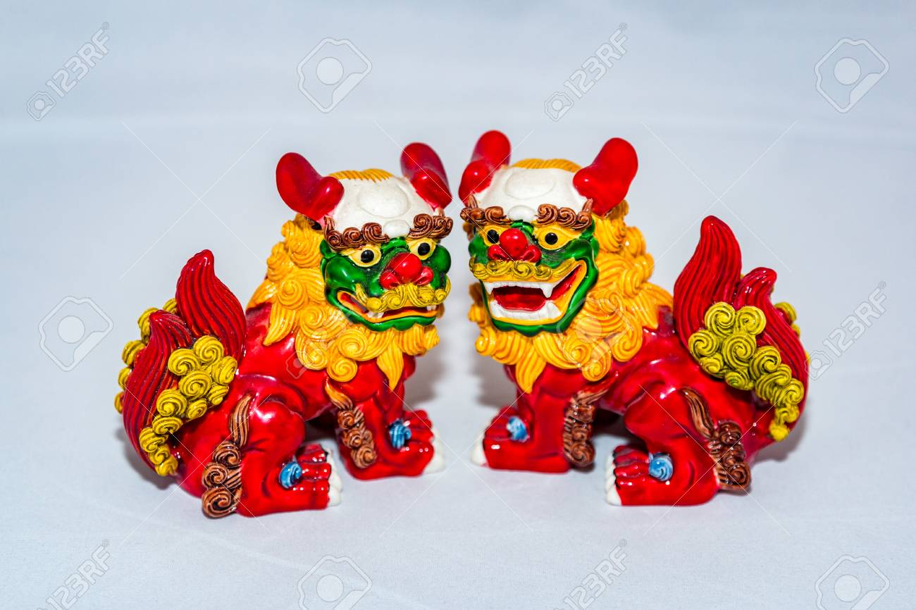 a small figure of a multi colored dragon of asian themes stock photo 96012355