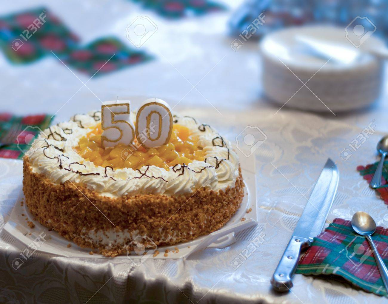 50th Birthday Cake On Table In Poor Family Stock Photo