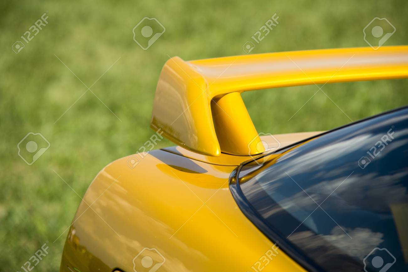 Closeup detail of a custom racing spoiler on the rear of a sports car - 36583372