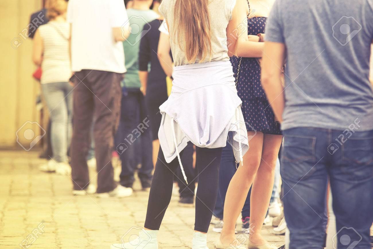 Long queue of people, vintage effect - 53692675