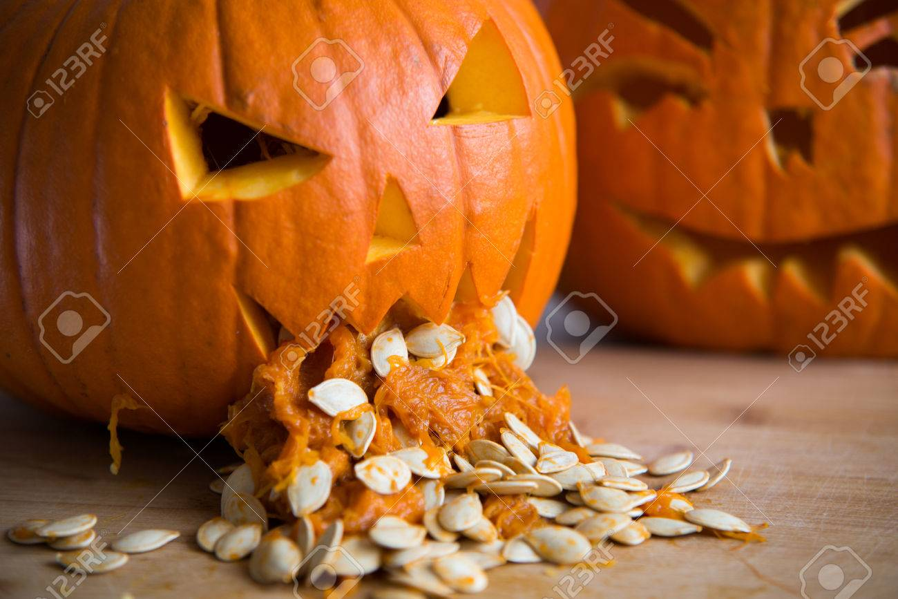 Halloween Kurbis Kotzt.Pumpkin Puking With Pumpkin Seeds On Wood Table Stock Photo Picture And Royalty Free Image Image 63712945