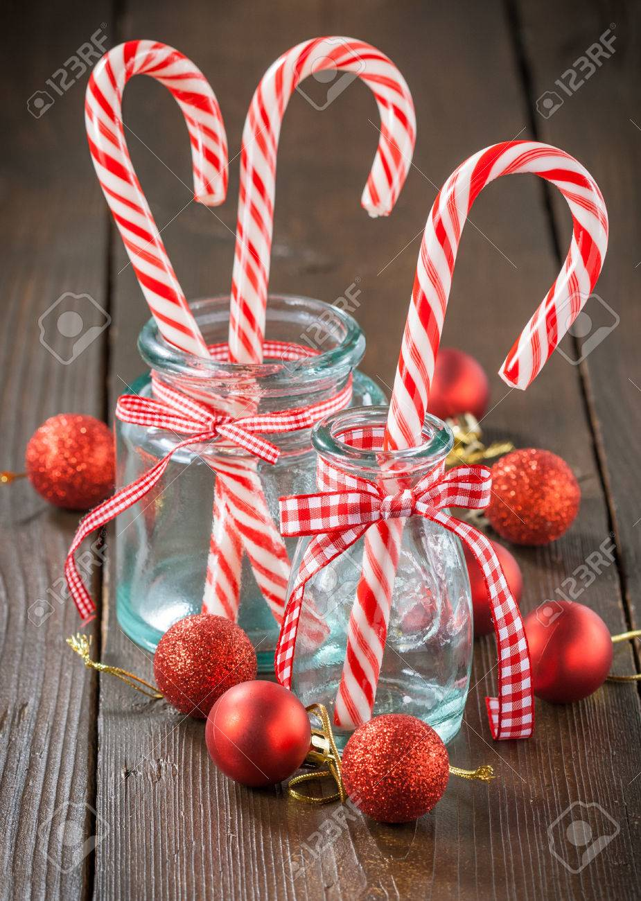 Glass candy cane ornaments - Christmas Candy Canes In Glass Jar Stock Photo 23716359