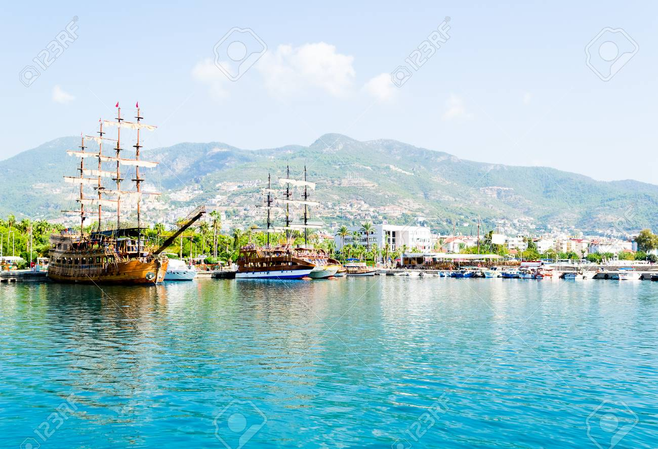Beautiful wooden ships sailing in the Mediterranean sea against the mountains of Turkey - 47622345
