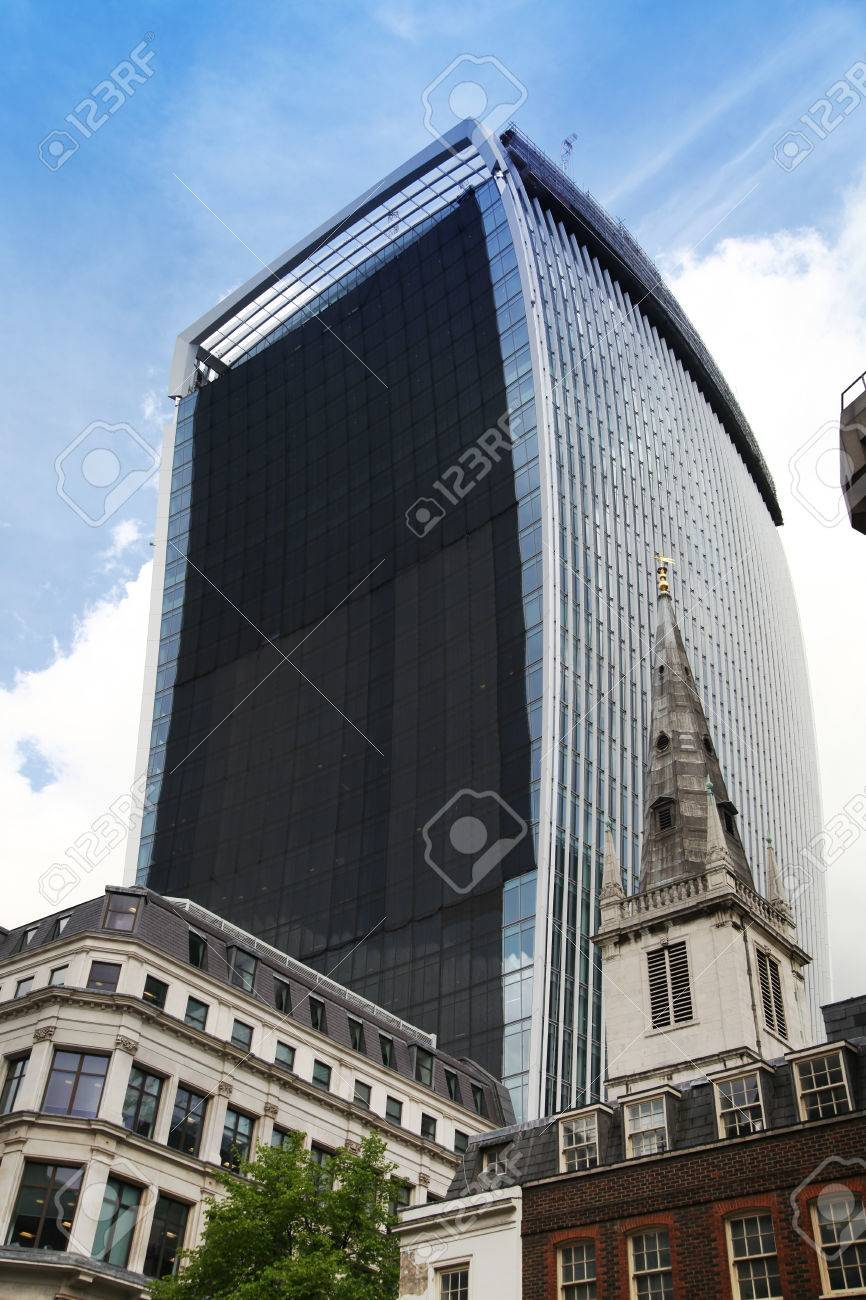 LONDON, UK - APRIL 24, 2014  Famous Walkie Talkie building still keeps iconic glass wall cowered  Wall was covered after it had started reflect very strong sun hit down on properties, roads and cars Stock Photo - 28196076