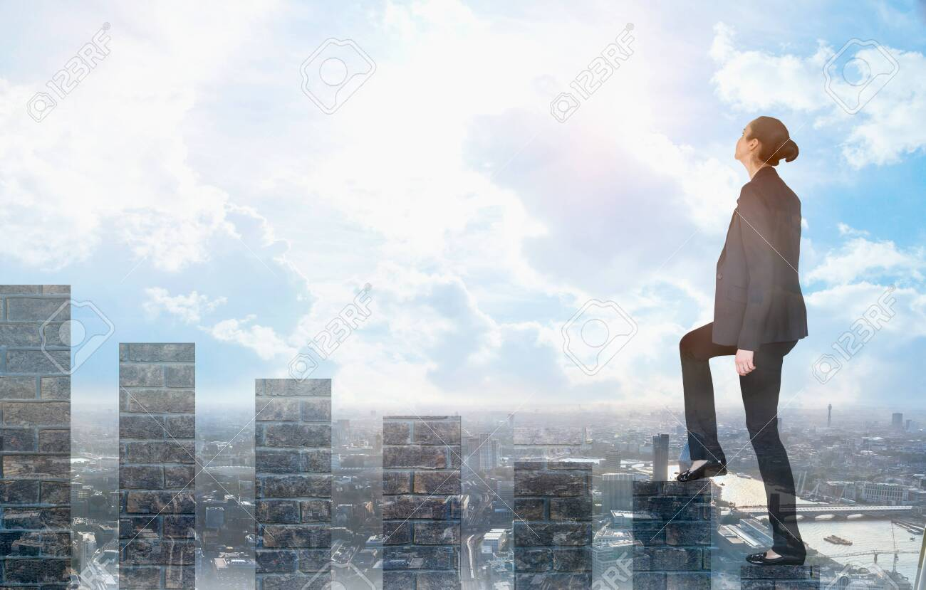 Young woman climbing up on the growth bars and looking positive to the future. Blue sky and sunshine. Business, success and strategy concept - 128780826