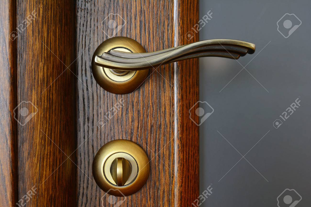 Vintage Brass Door Handle With A Latch And A Lock On The Wooden ...