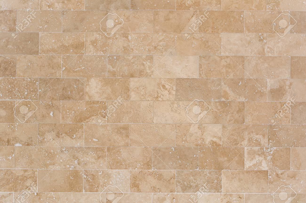 Stone facing of beige wall made of travertine. Texture of masonry. - 97503500