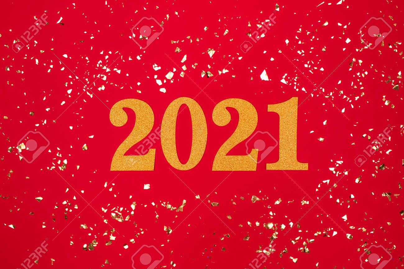 Festive background with 2021. Golden numbers on red background with holographic sparkles around - Happy New Year celebration concept. Christmas holidays 2021 celebration - 158746637