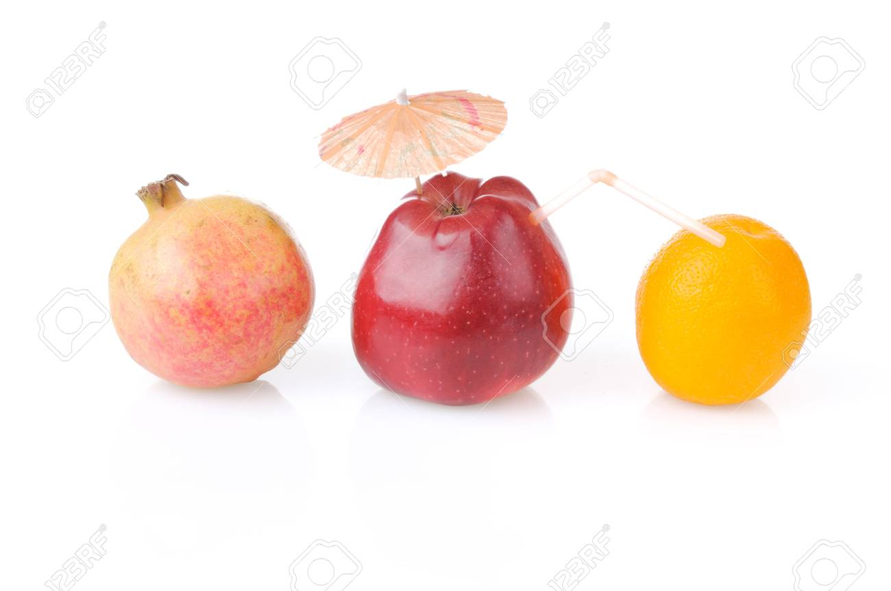 Red apple with umbrella and tube, one pomegranate and orange Stock Photo - 5711520