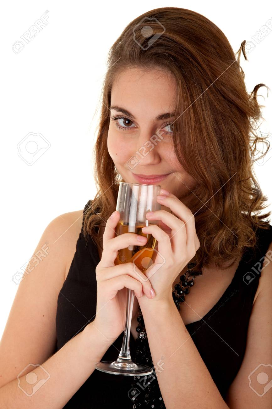 Beautiful woman with a glass of champagne on white background. Focus on woman's eyes. Stock Photo - 6105595