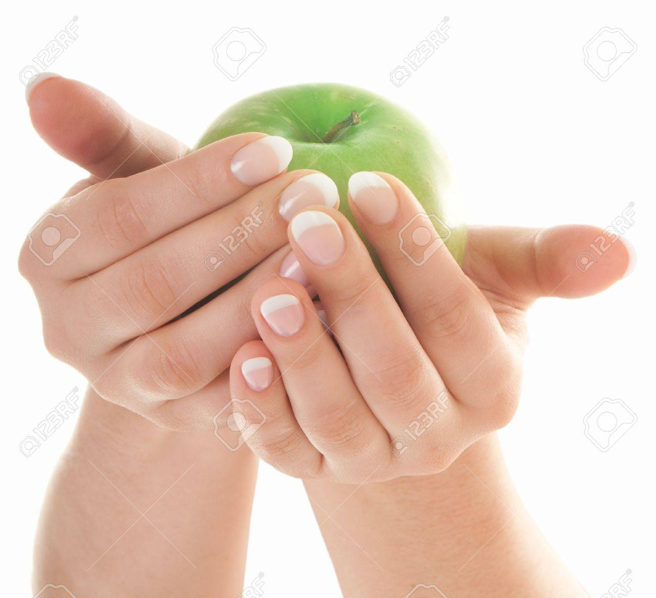 Green fresh apple in beutiful female hands with nice french manicure isolated on white background - 6900705