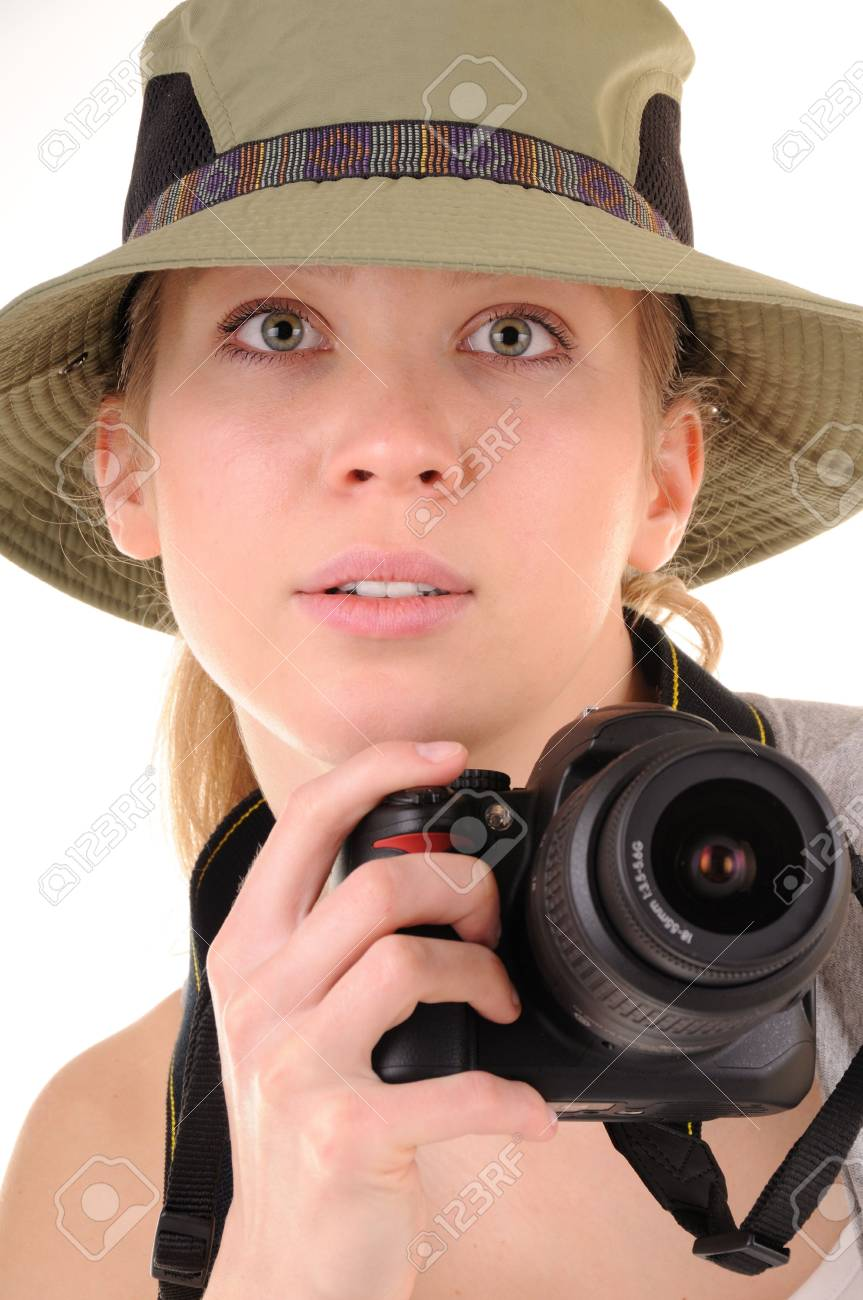 Portrait casual girl-tourist with digital photocamera. Focus on woman's eyes Stock Photo - 6900766