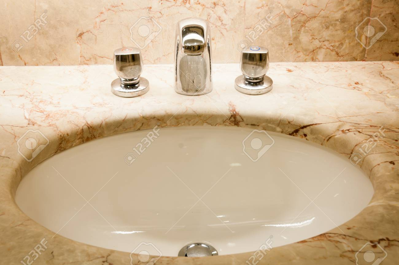 Faucet with handles and white sink Stock Photo - 10915732