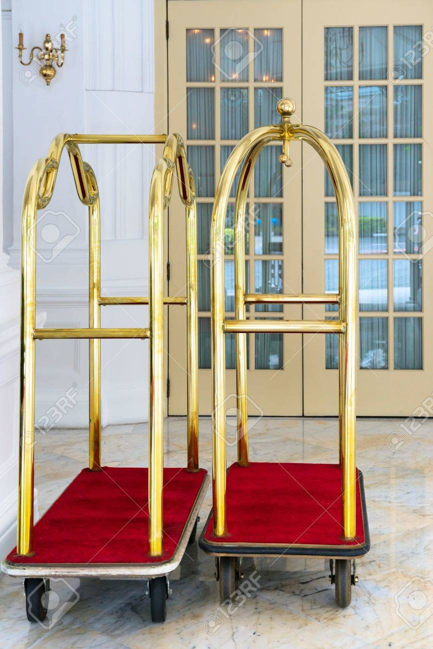 Stock Photo - Two vintage hotel baggage carts with door on background & Two Vintage Hotel Baggage Carts With Door On Background Stock Photo ...