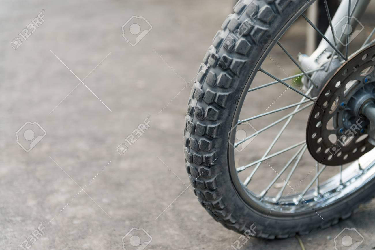 Off-road motorcycle tires on dusty ground  Selective focus on the front part Stock Photo - 16988487