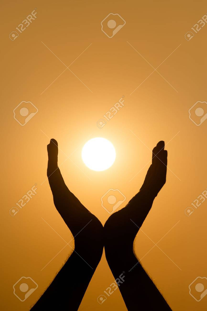 Hands holding the sun at yellow sunset background Stock Photo - 17312786