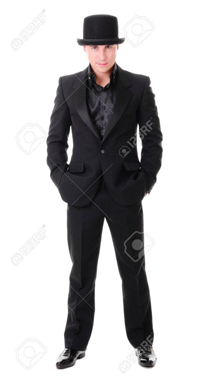 8e25ebded7 Elegant full-length young man in black suit and hat derby isolated on white  background