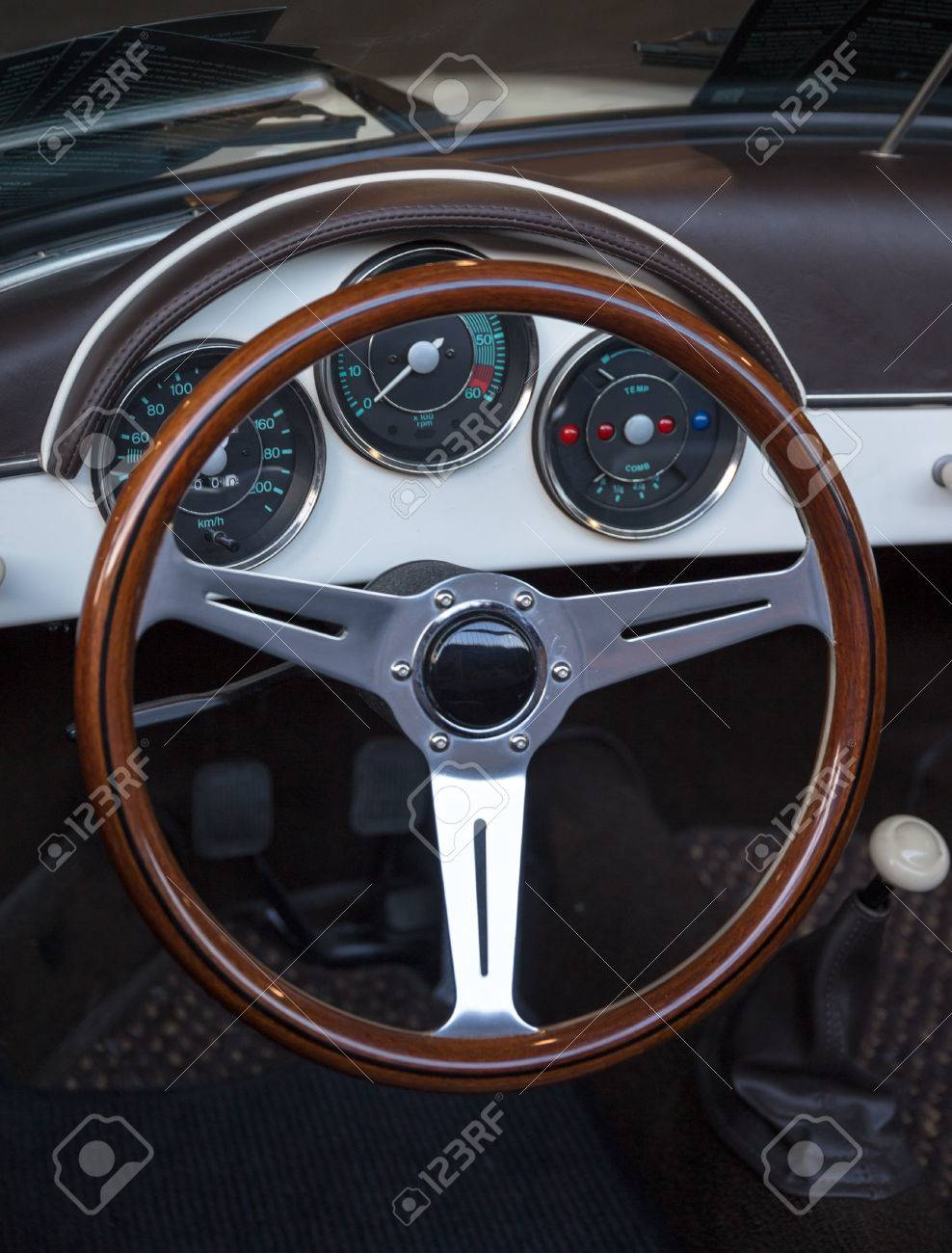 Wooden Steering Wheel And Brown Leather Dashboard Of A Classic ...