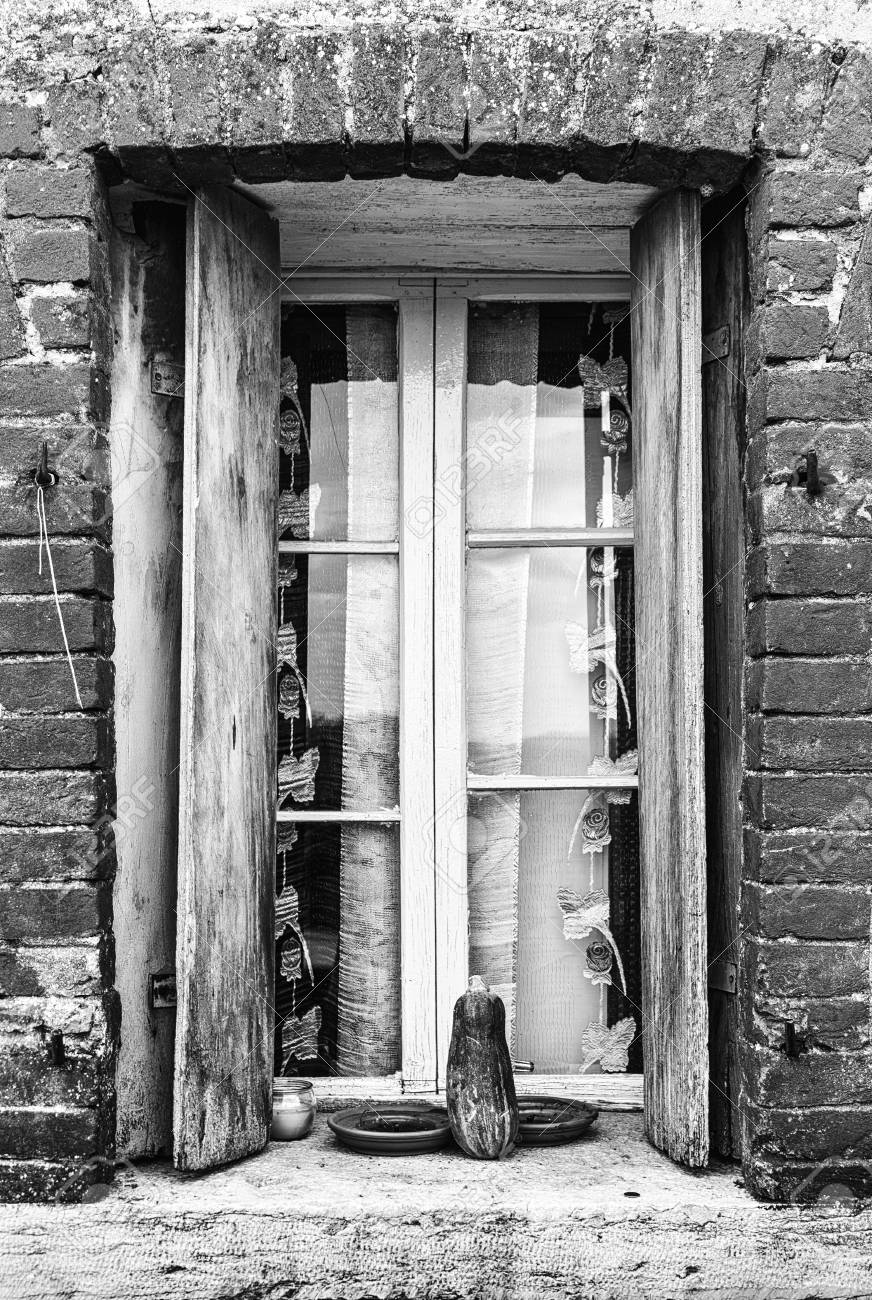 Window Of A Farmhouse With Wooden Balconies And Red Brick Frame ...