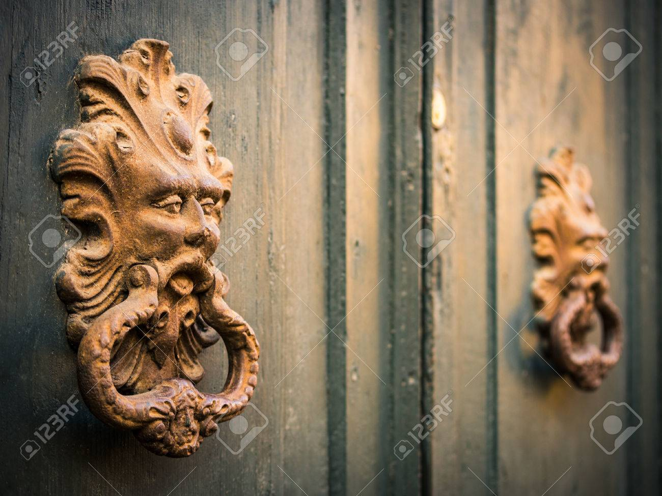 Picture of: Antique Door Knockers Of An Old Door Stock Photo Picture And Royalty Free Image Image 70907793