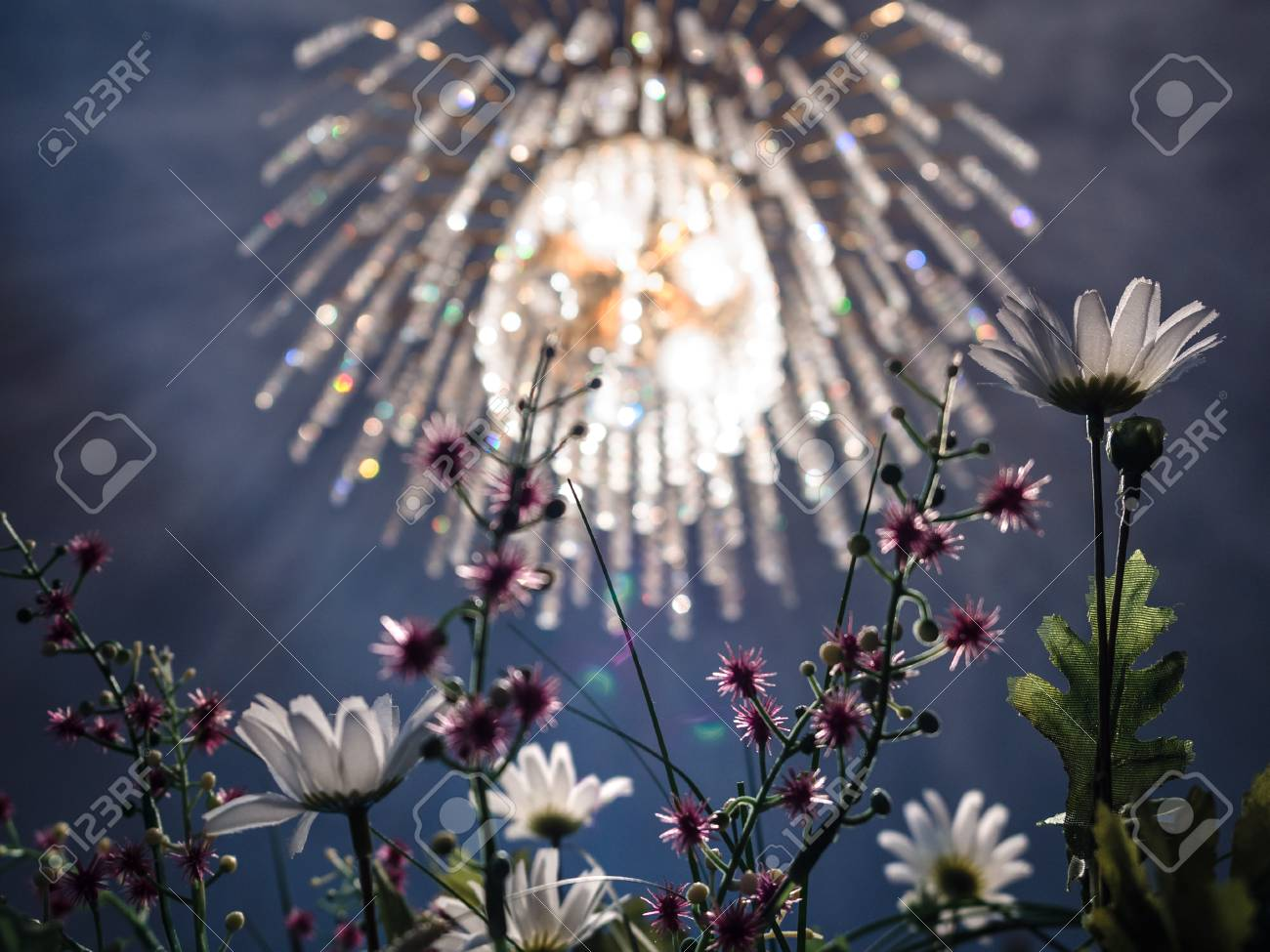 Crystal Chandelier With Golden Light And Artificial Flowers Stock Photo 86794754