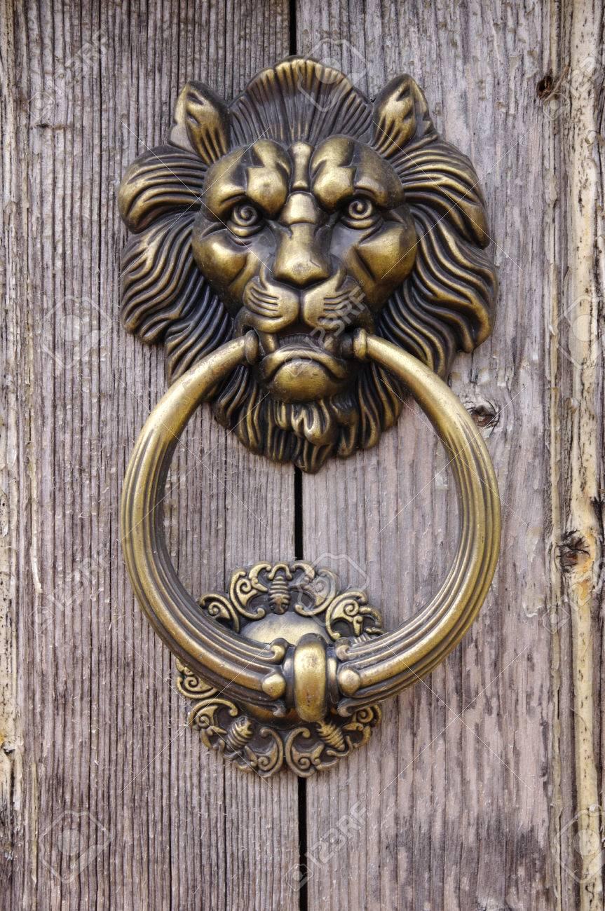 Lion Head, Door Knocker On Old Wooden Door Stock Photo   27355344