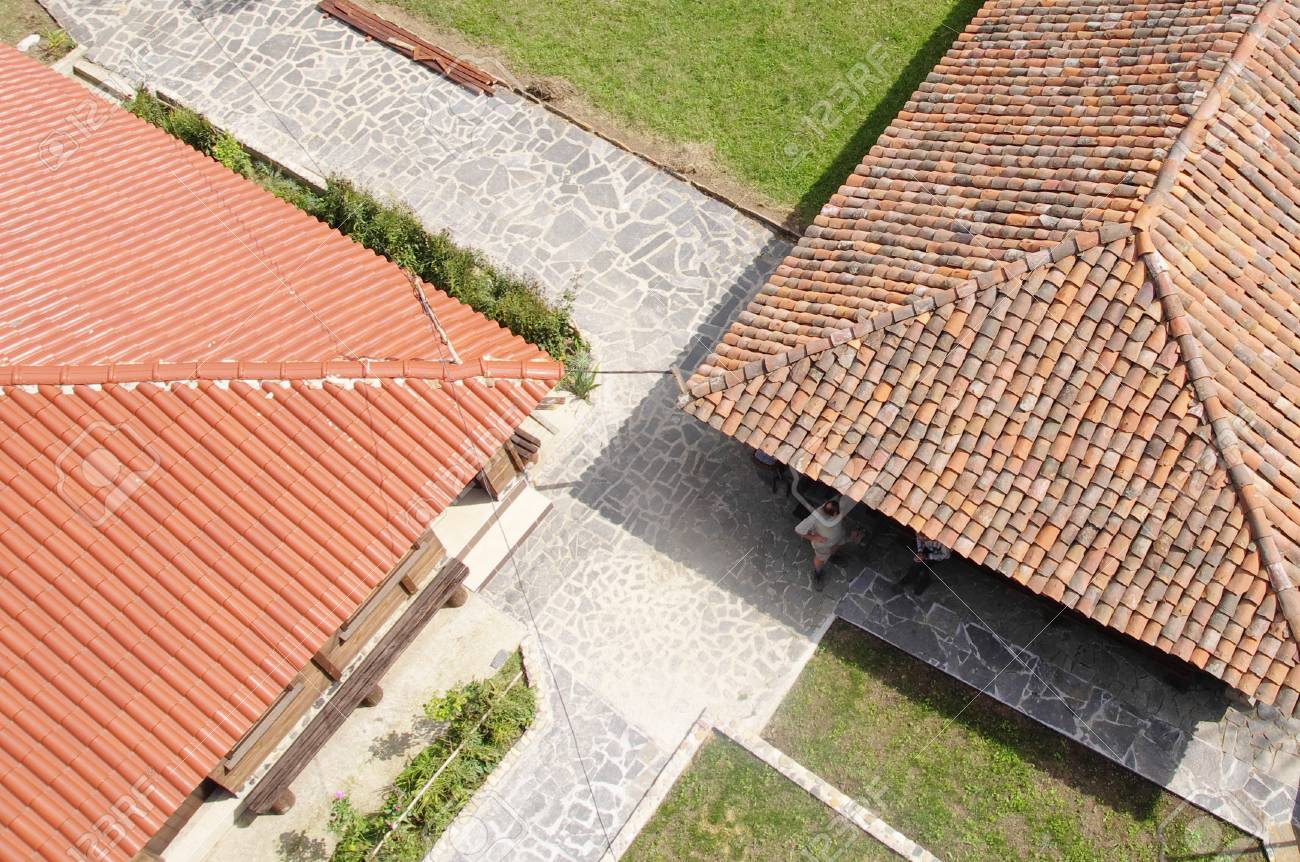 Old And News Roof With Colorful Ceramic Tiles In Sunny Day Stock ...