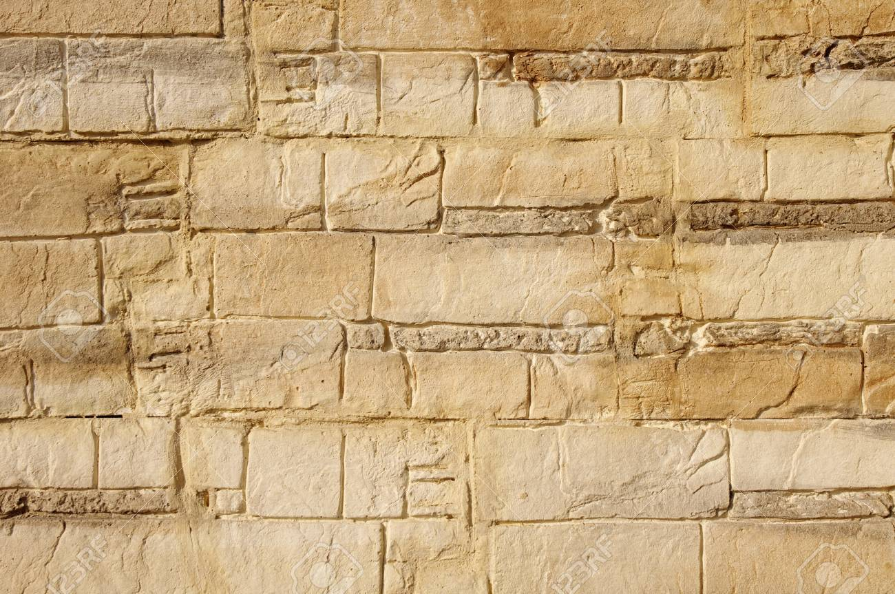 Decorative Relief Brown And Ecru Plaster Imitating Stone Wall Stock ...
