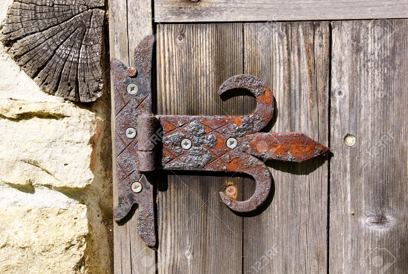 Rusty Door old rusty door hinge on wooden door stock photo, picture and