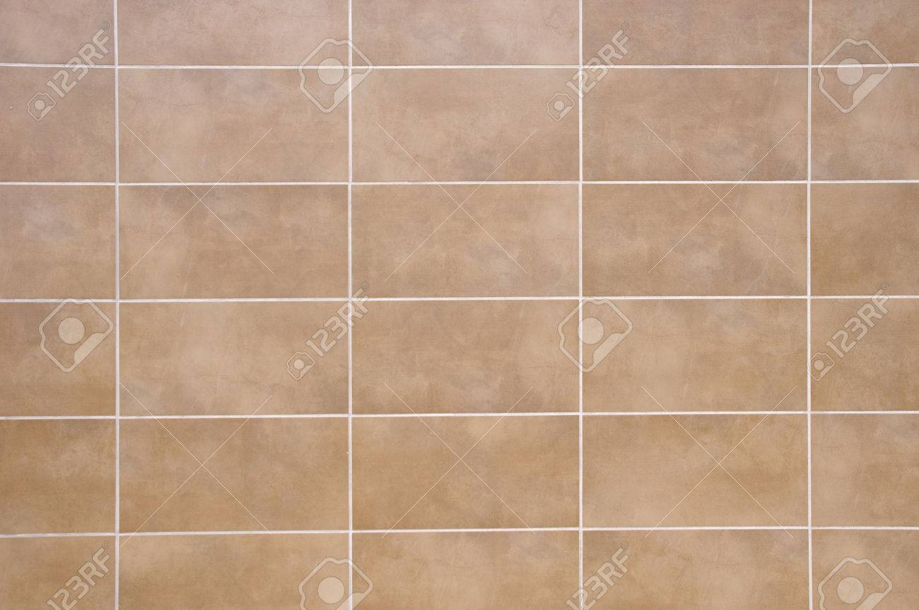 Brown Ceramic Tiles With White Fugue On Wall Closeup Stock Photo ...