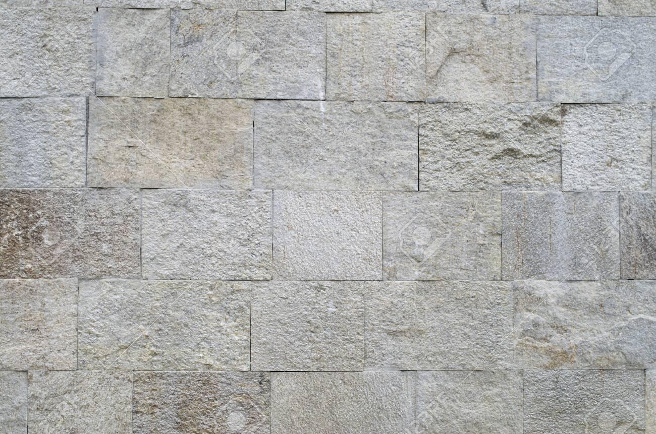 New polished sliced stone cladding on wall closeup - 121251089